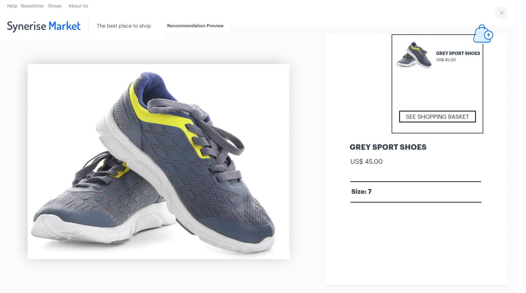 """An exemplary product page with sports shoes, in the corner a shopping bag icon and a tab with the """"See shopping basket"""" info"""